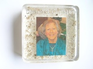 Square shaped paperweight containing ashes and a photograph