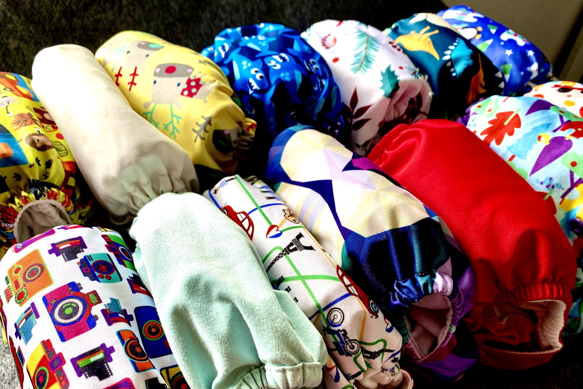 A close up of various cloth reusable nappies to illustrate getting started with cloth