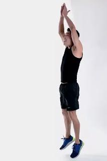 man practicing squats