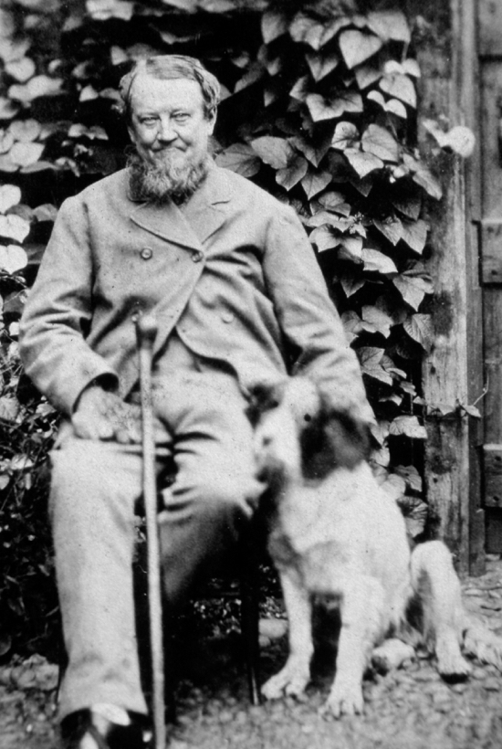 Photograph of William Cozens born 1819, sitting with his spaniel Rover. William was a master baker in Bell Bar