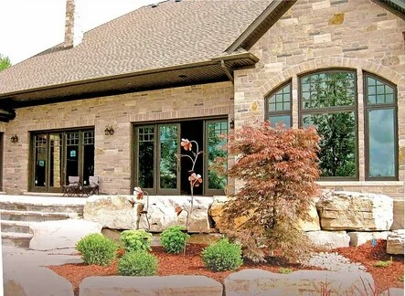 Gray decorative stone for finishing the exterior of the house