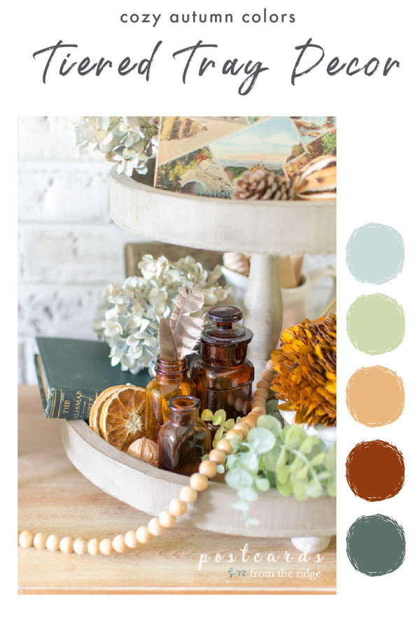 vintage and natural fall decor on a wooden tiered tray