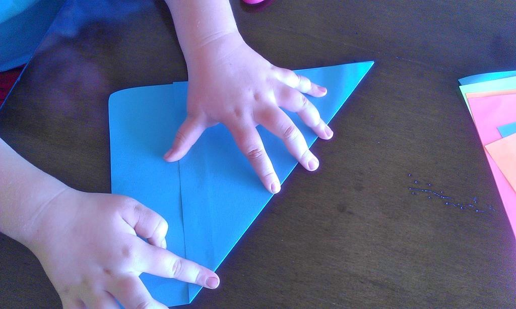 Fold One Piece Of Paper Across On The Diagonal Evenly Which Will Leave An Extra Amount At Bottom