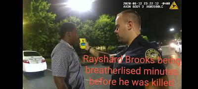 rayshard brooks and officer garrett rolfe before shooting