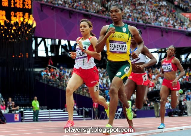 Caster Semenya of South Africa (c.) finishes with a silver in olympic