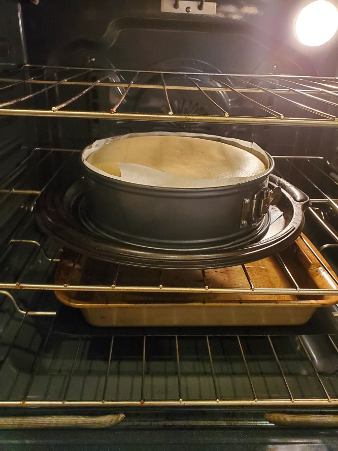 this is a cheesecake baking with a water bath pan on another rack in the oven