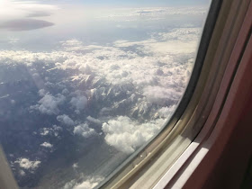 clouds and mountain tops from plane window over France