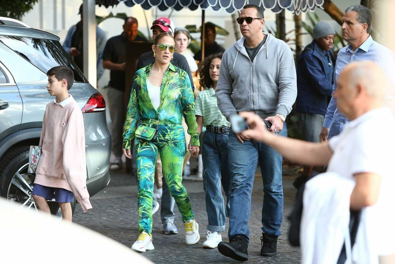 Jennifer Lopez heads out for brunch with family clad in tropical Versace separates in Miami