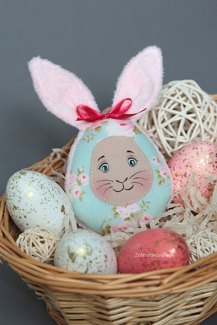 Aesthetic Easter egg with bunny ears from fabric