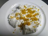 Mixing grated orange skin with chenna for orange rasgulla recipe
