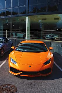 sportscar orange lamborghini huracan parking luxury