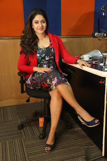 Actress Poonam Bajwa Pictures in Floral Dress at Radio City FM For Kalavathi Movie Promotion  0021.jpg