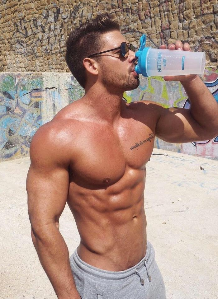 shirtless-muscle-beast-sun-tanning-male-pecs-dude-drinking-grindr-profile-pic