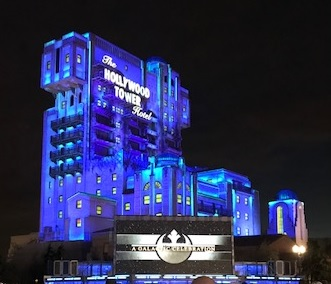 The Tower of Terror ride lit up at night