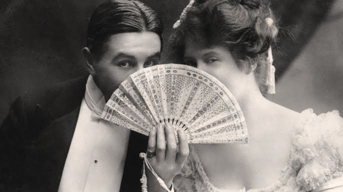 Victorian couple flirt behind a fan. Frighten the Horses. marchmatron.com