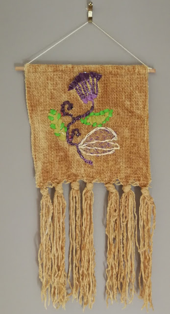 Embroidered piece with plastic strips