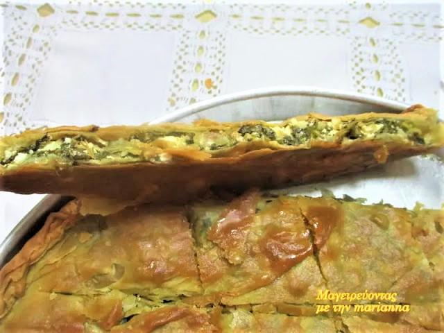 Λεπτή χορτόπιτα με άγρια χόρτα του βουνού, ψημένη σε ξυλόφουρνο