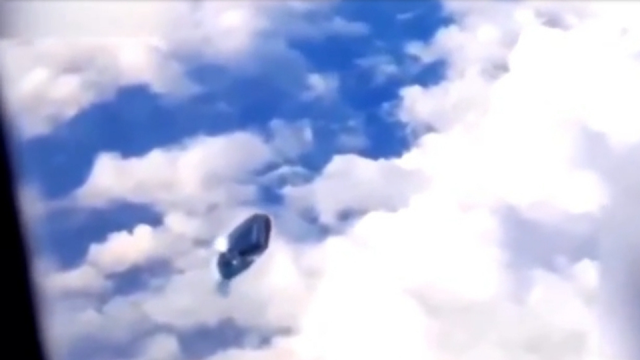 This is an excellent UFO filmed out of the window of a plane.