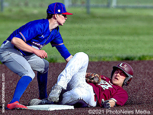 Damian Knoll slides into second