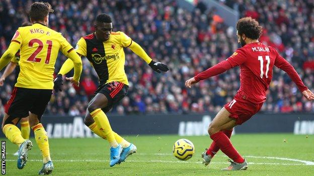 Mohamed Salah scored twice as Premier League leaders Liverpool battled to victory over strugglers Watford in Nigel Pearson's first game in charge
