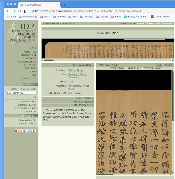 Screen shot with light blue frame showing website with yellowish-grey bar left side bar, white background, images of yellowed scrolls with Chinese characters on them and a greyish yellow text box.