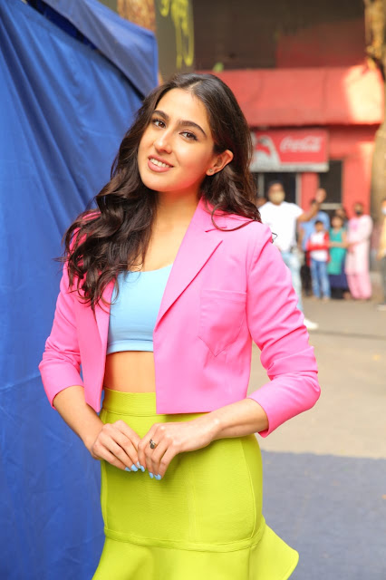 Sara Ali Khan in Neon Pink-Green-Blue Colour Block Blazer-Skirt Piece poses in filmcity