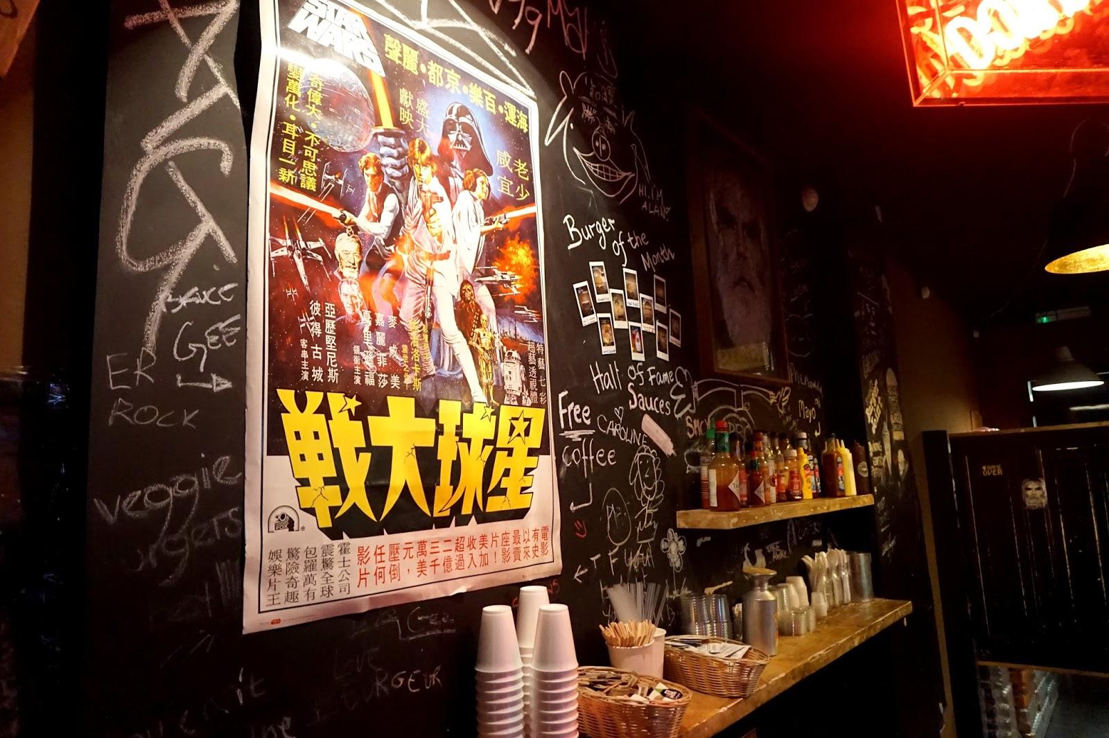 """<img src=""""tommis burger joint kings road.jpg"""" alt=""""restaurant decor"""" />"""