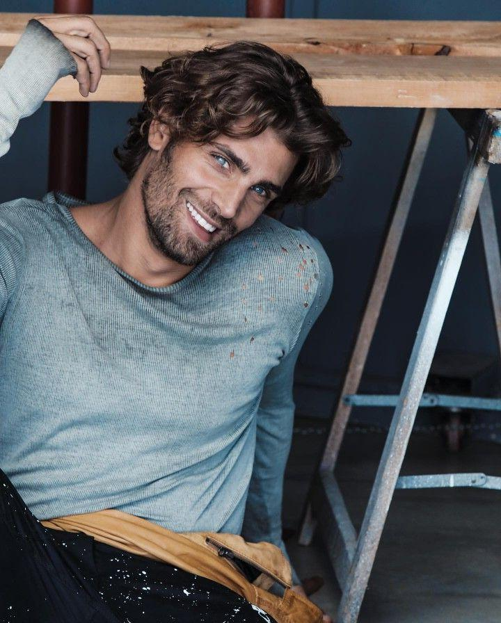 beautiful-guys-blue-eyes-smiling-white-teeth-curly-brunette-male-hairstyle
