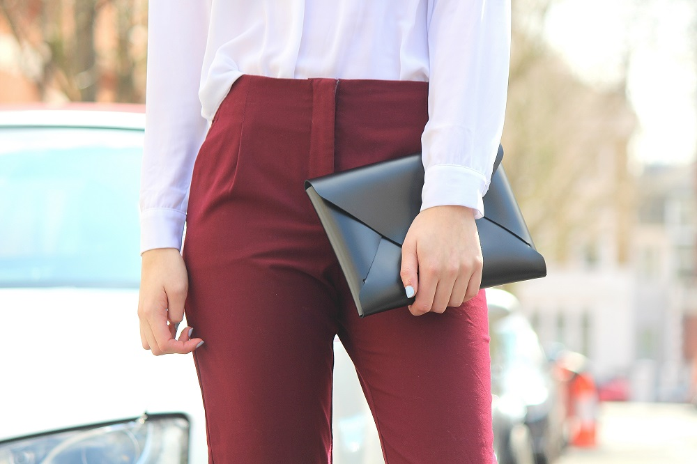 peexo fashion blogger wearing smart trousers and white blouse with strappy sandals