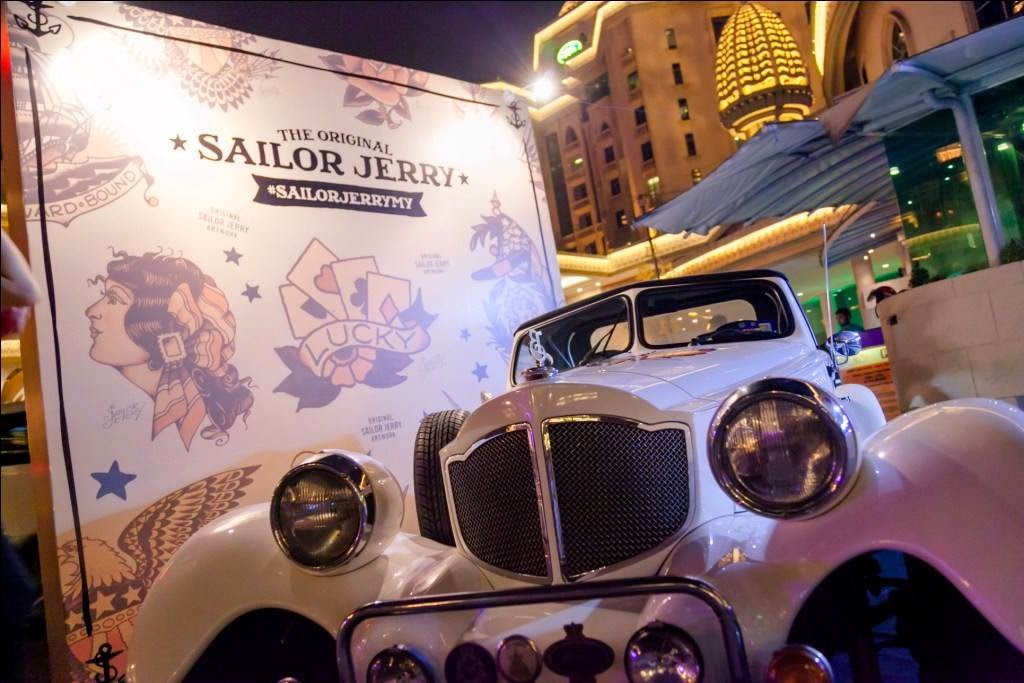 A vintage Sailor Jerry themed car at the entrance