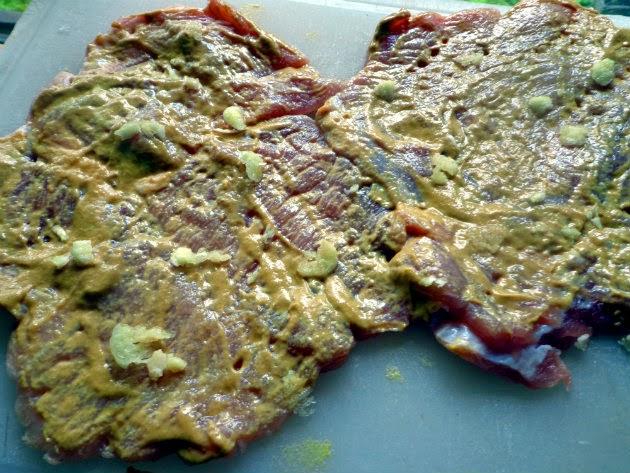 smear pork steaks with mustard