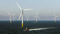 File Photo: A crew boat passes through Horns Rev 2, the world's largest wind farm, 30 km (19 miles) off the west coast of Denmark near Esbjerg September 15, 2009. (Credit: Reuters/Bob Strong/File Photo) Click to Enlarge.