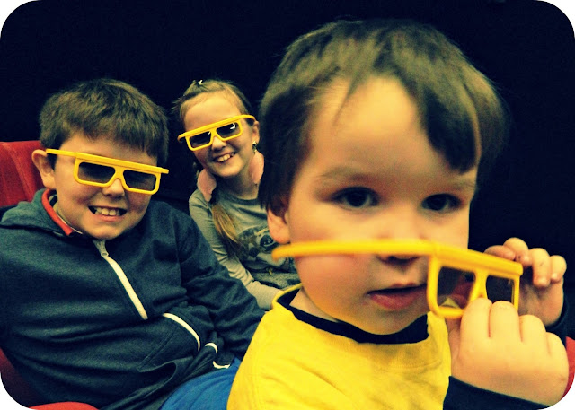 Kids Children wearing 3D glasses cinema film