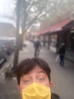 Greig Roselli wears a yellow mask in Jackson Heights, Queens