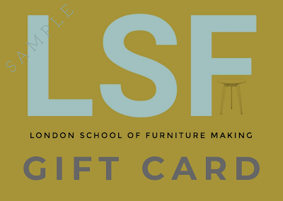 Image of the letters LSF and Gift Card pale blue on khaki background