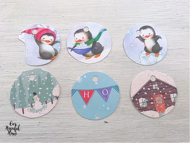 six round Christmas gift tags