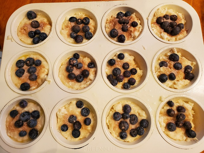 this is a 12 cup muffin tin with blueberry batter in them
