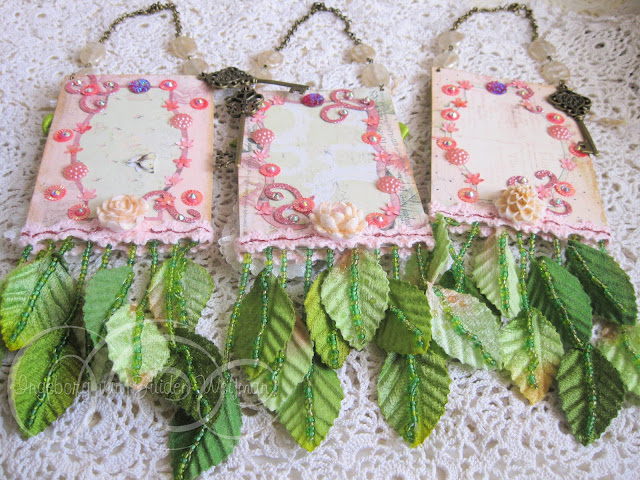 Backside of handmade tags with beaded leaves