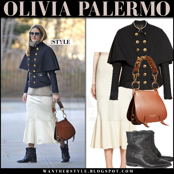 Olivia Palermo in military gold button cape jacket burberry, cream skirt, ankle boots and tan leather bag burberry the bridle what she wore