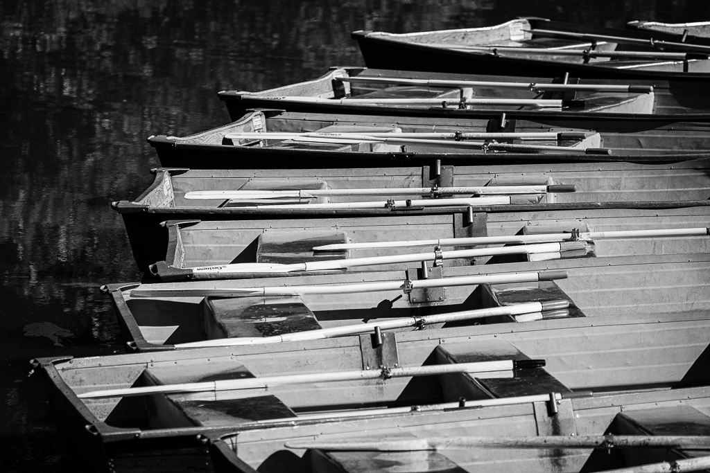 a black and white photograph of boats in central park new york