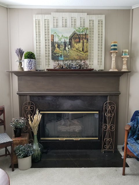 brown and black fireplace mantel