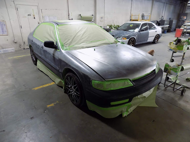 1995 Honda Accord getting masking for paint at Almost Everything Auto Body.