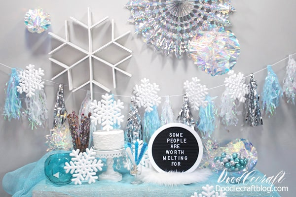 Disney's Frozen birthday party themed ice princess blue and silver winter wonderland holiday decorations