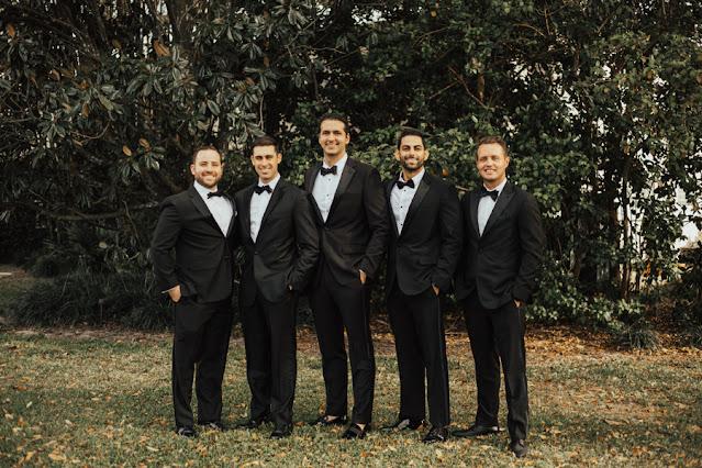 groom and groomsmen in tuxes