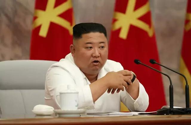 Kim Jong Un at WPK 7th CC 14th Political Bureau Enlarged Meeting