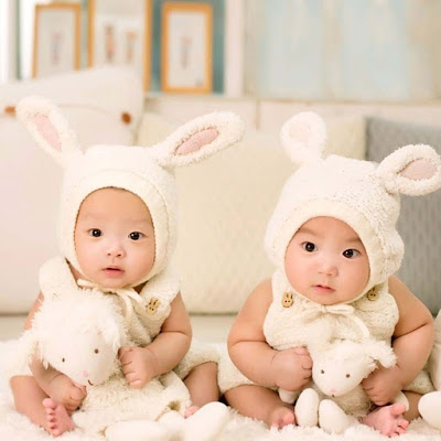twins-babies-sitting-with-wearing-rabbit-type-clothes