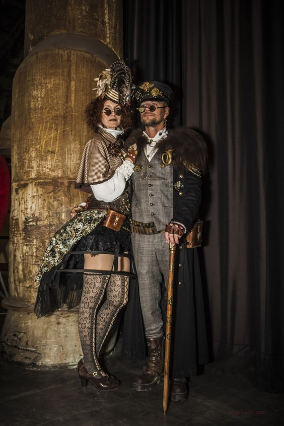 Steampunk couple in luxe fabrics and cool accessories. Steampunk clothing and fashion for men and women
