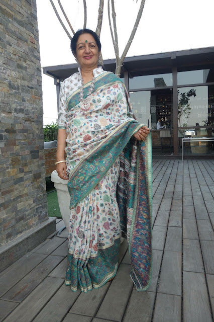 White and green kani saree