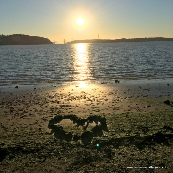 sunset at Benicia waterfront with rock heart in Benicia, California