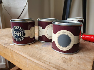 Image of four small paint tins